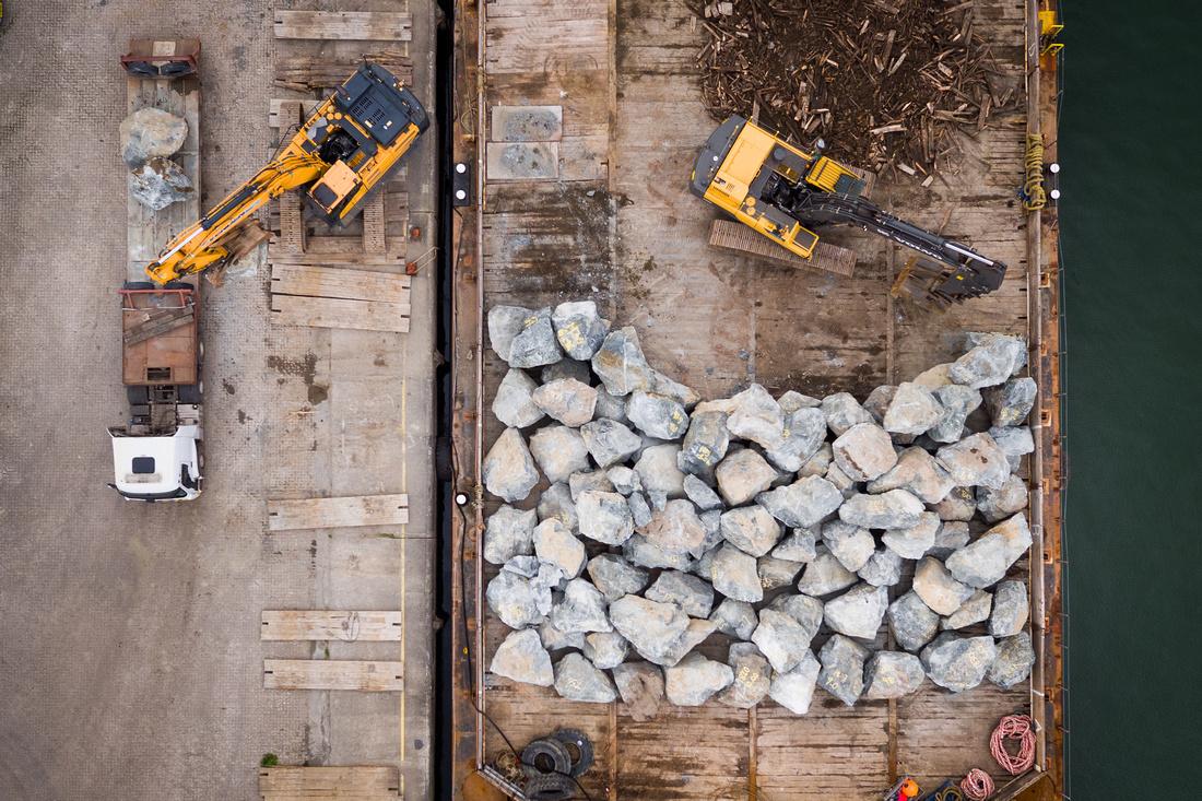 Vertical drone view of boulder loading at Pembroke Port