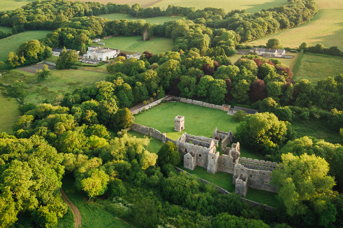 Lamphey Palace ruins with Lamphey Court in the background, photographed from the air using drone cam