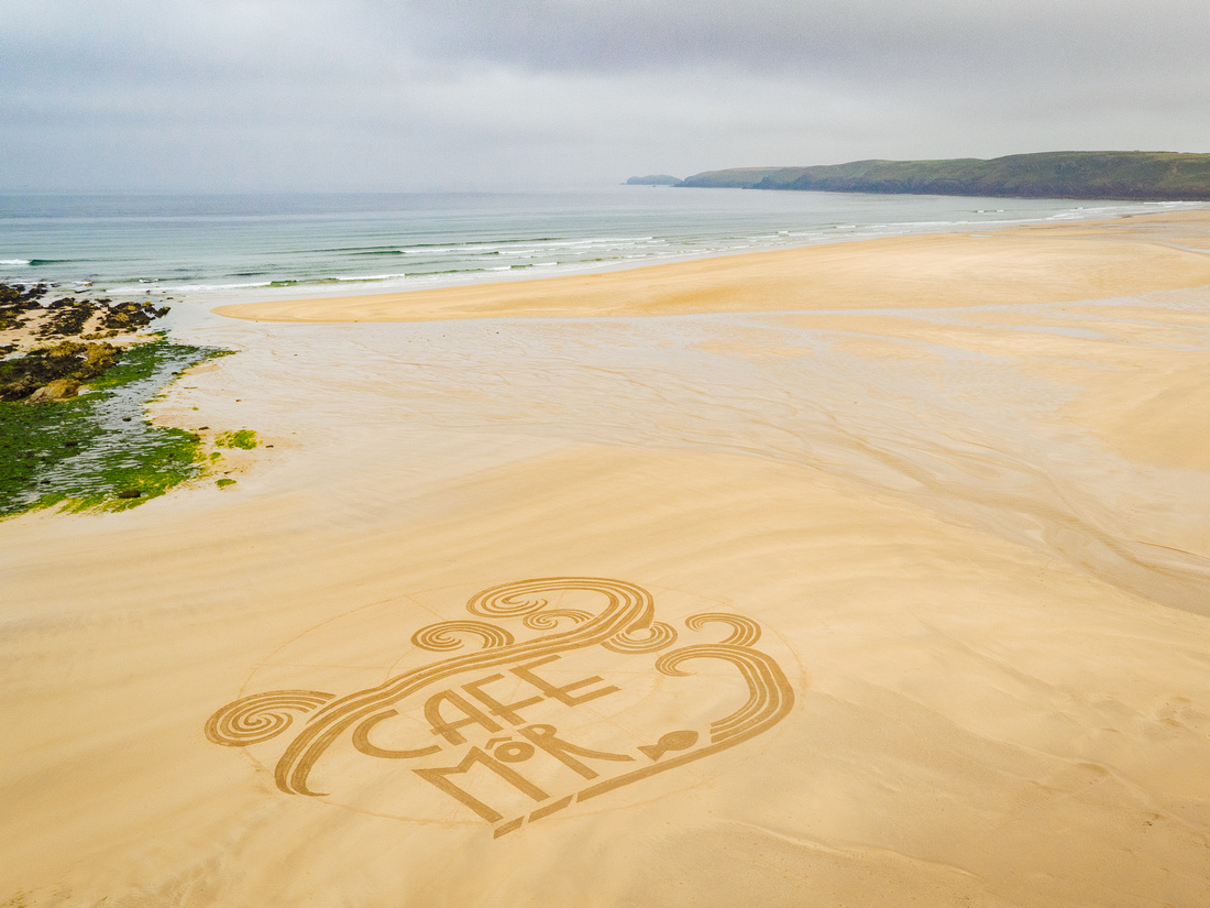 Aerial drone image of sand art for Cafe Mor at Freshwater West beach